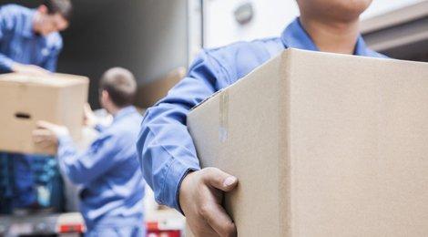 men transporting carton boxes