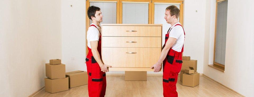 2 men carrying wooden case