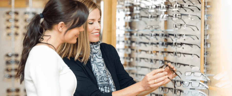 a woman choosing a pair of glasses