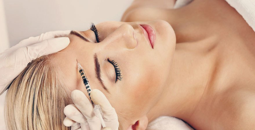 Fillers being injected into a lady's forehead