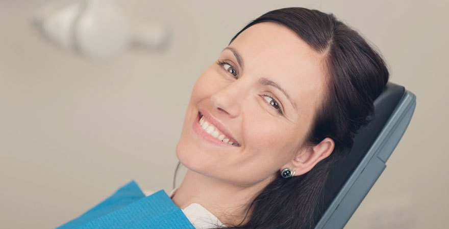 A dark haired lady in the dentist's chair