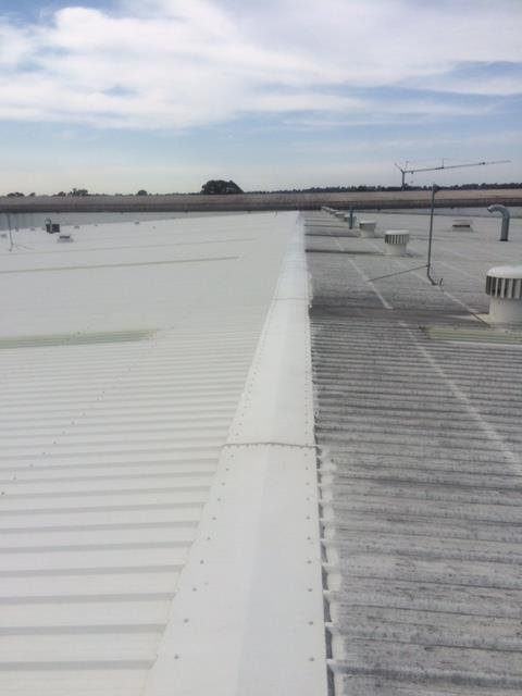 metal roof half cleaned