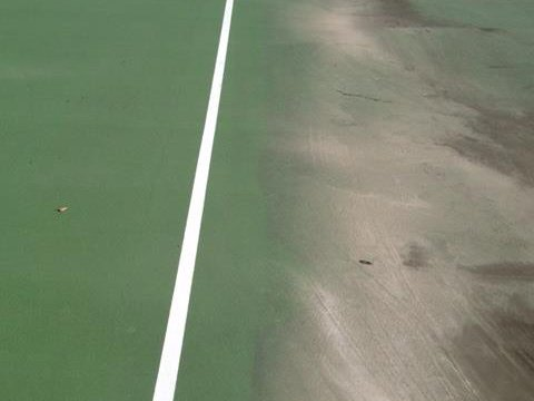 cleaning the tennis court