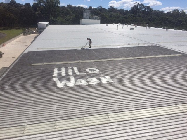 hilo wash words on dirty metal roof