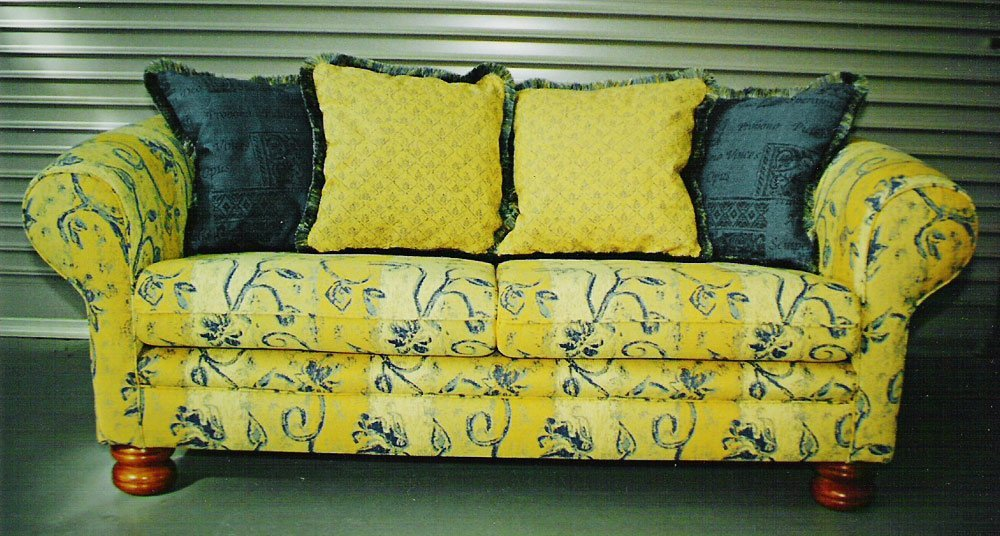 yellow settee and cushions