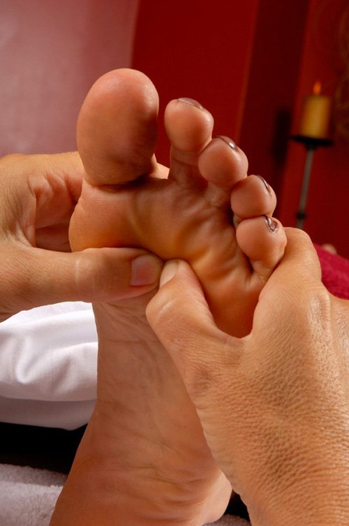View of a woman's foot acupressure