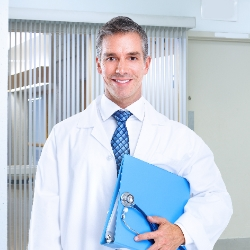 Friendly doctor holding medical folders