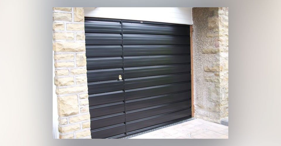 Side hinged garage door fitting