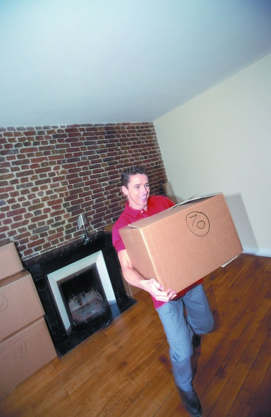 Removal service - Coventry - W Grace Removals - Holding a box