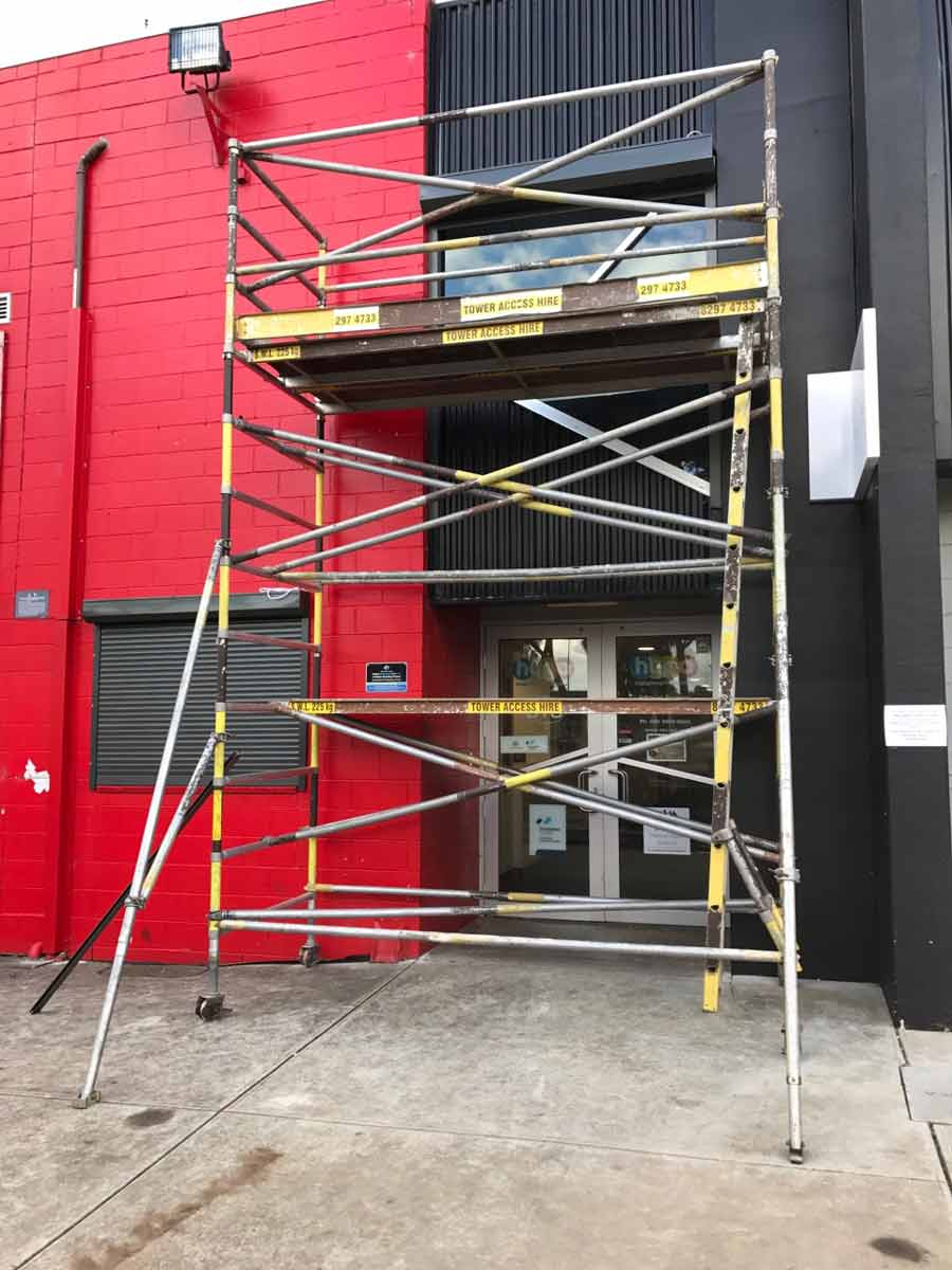 scaffold on a red and black building