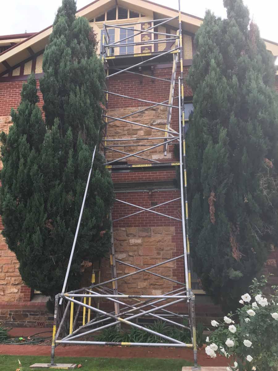 scaffold along a brick home