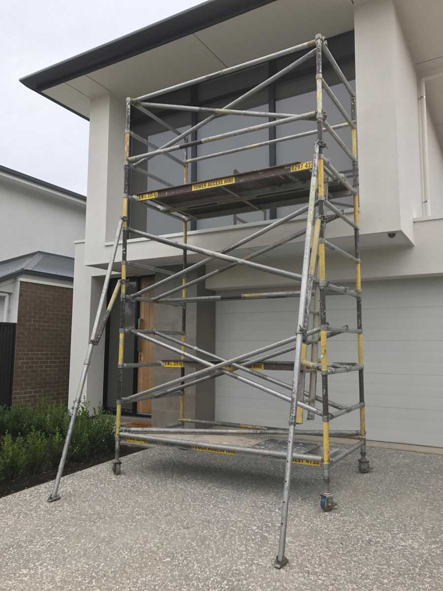 scaffolding leading to a second story house window