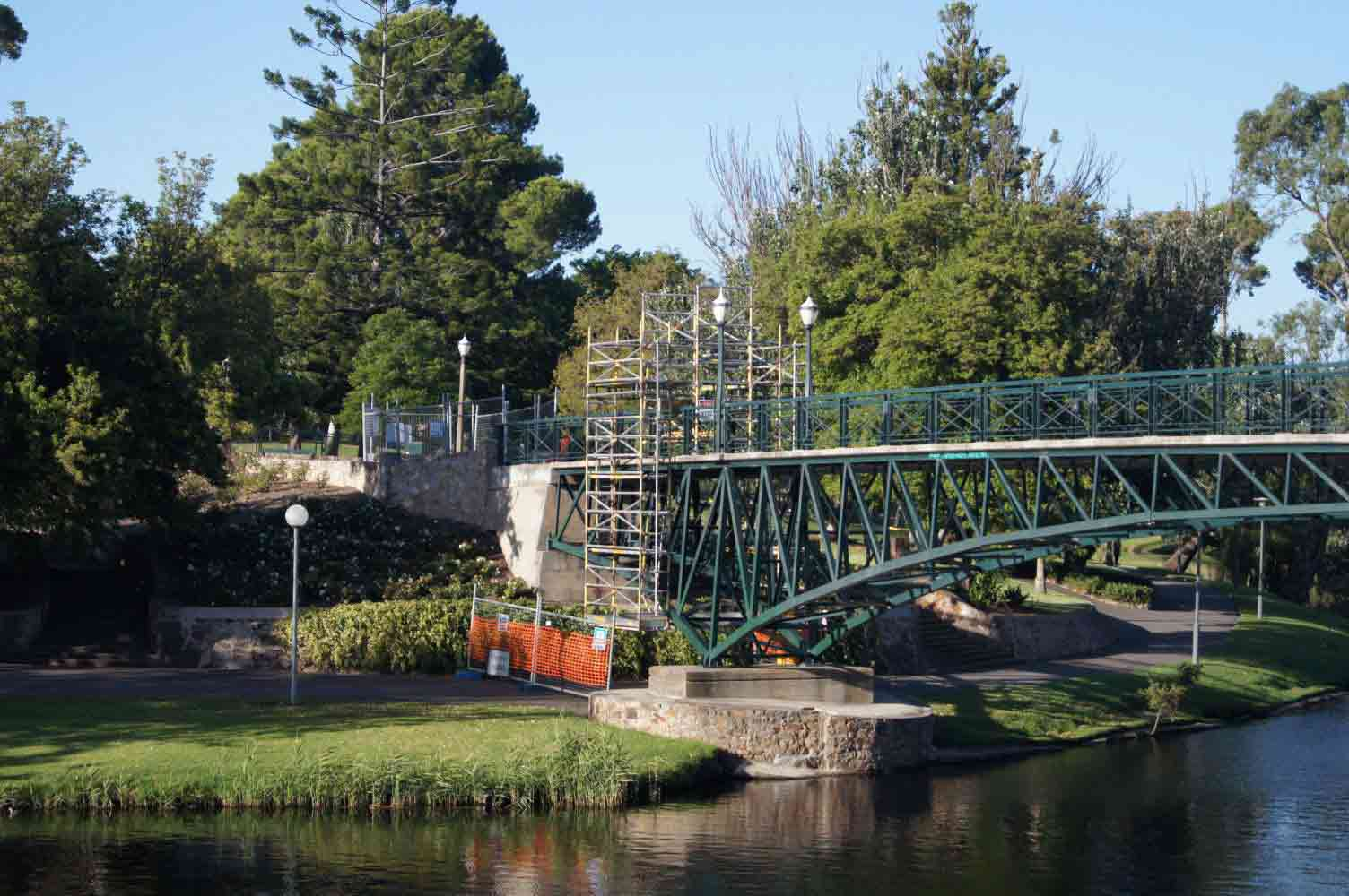 scaffolding on long green bridge