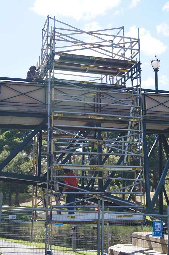 scaffolding going over bridge