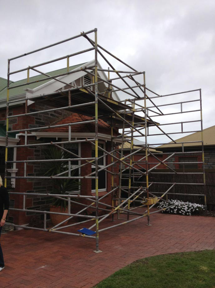 house covered in scaffolding