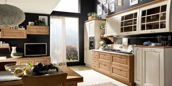 Grande spazio metà soggiorno , metà cucina . Il soggiorno di legno i nero, e la cucina di legno e bianca.