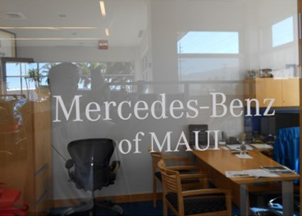 Mercedes-Benz of Maui glass wall featuring the logo