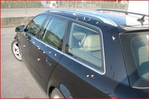 auto nera con fiancata rovinata