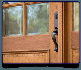 Close up image of steel door handle on a wooden door