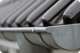 Close up image of grey guttering