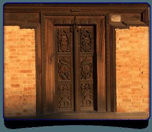 Wooden door with crafted figures