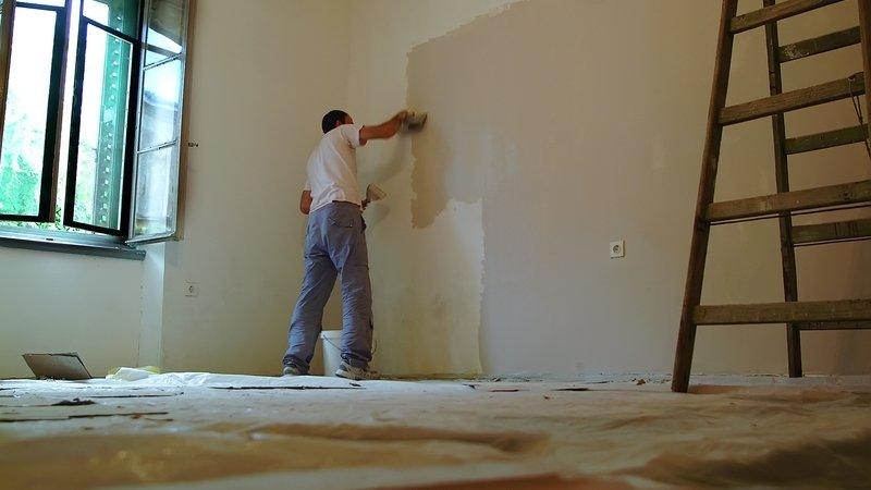 Man painting drywall