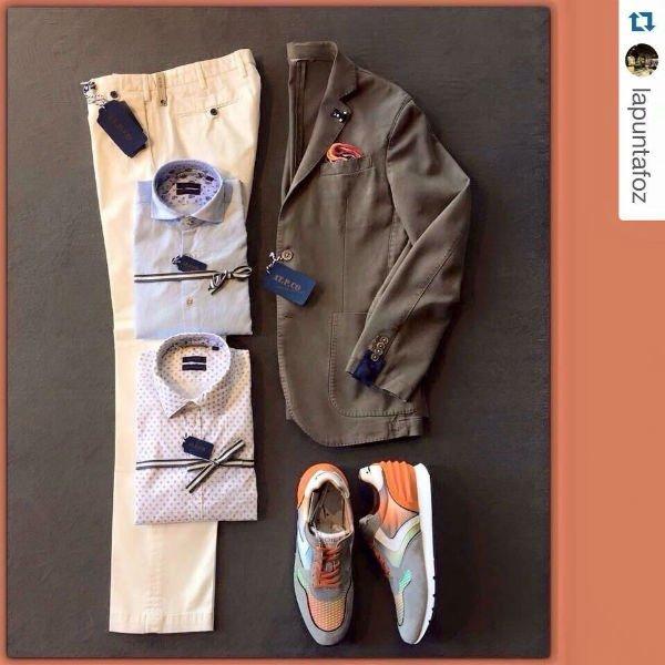 un paio di pantaloni color avorio, due camicie e una giacca di color grigio scuro