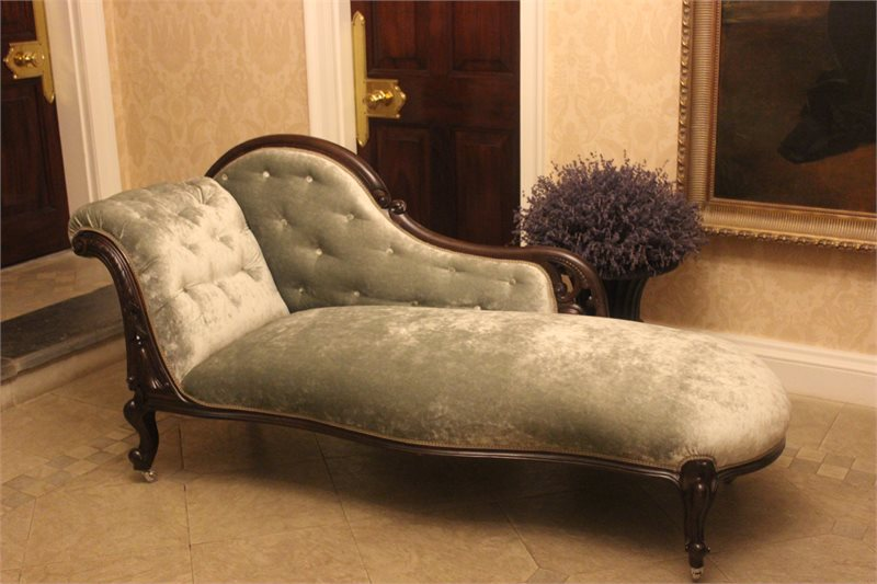 chaise longue upholstered in pale gold