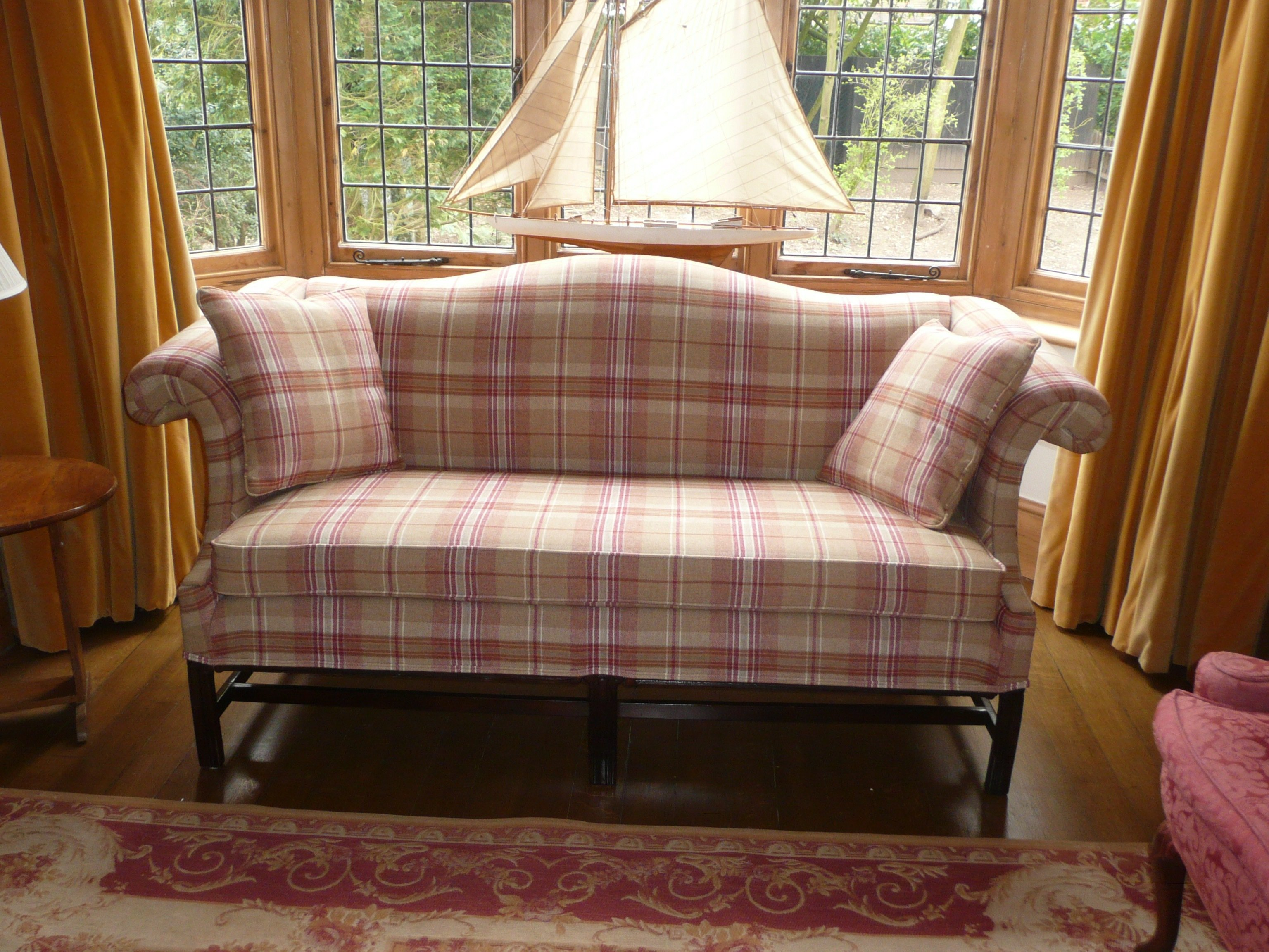 sofa upholstered in modern retro tartan