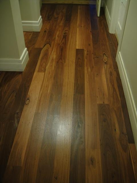 Residential hallway with timber flooring