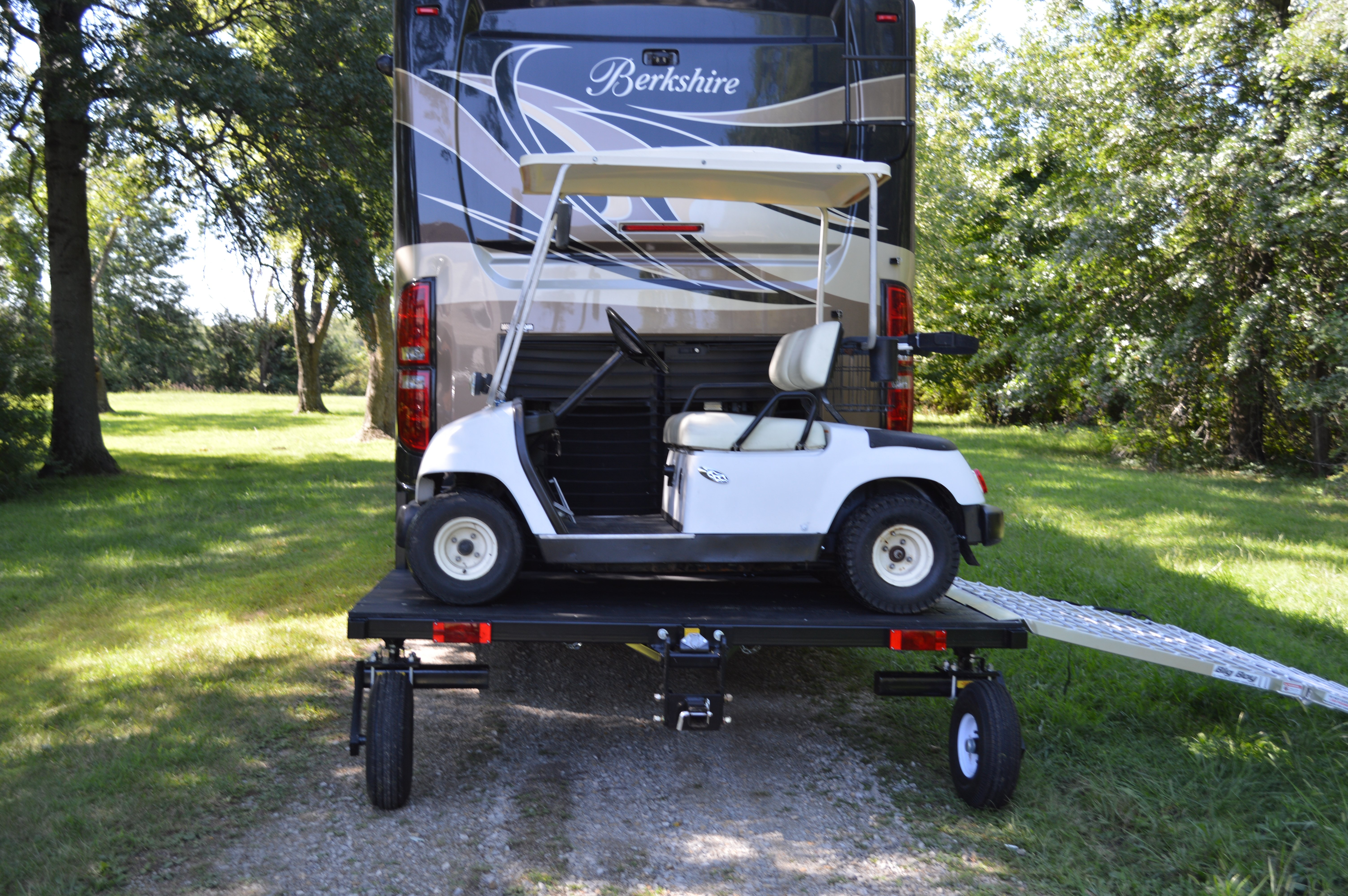 Dual Wheel Transport system holding a golfcart