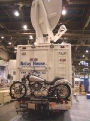 RV motorcycle Lift on Sattelite Uplink Truck