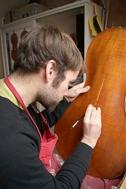 Cello varnish retouch - Edward Gaut Violins - Bristol UK