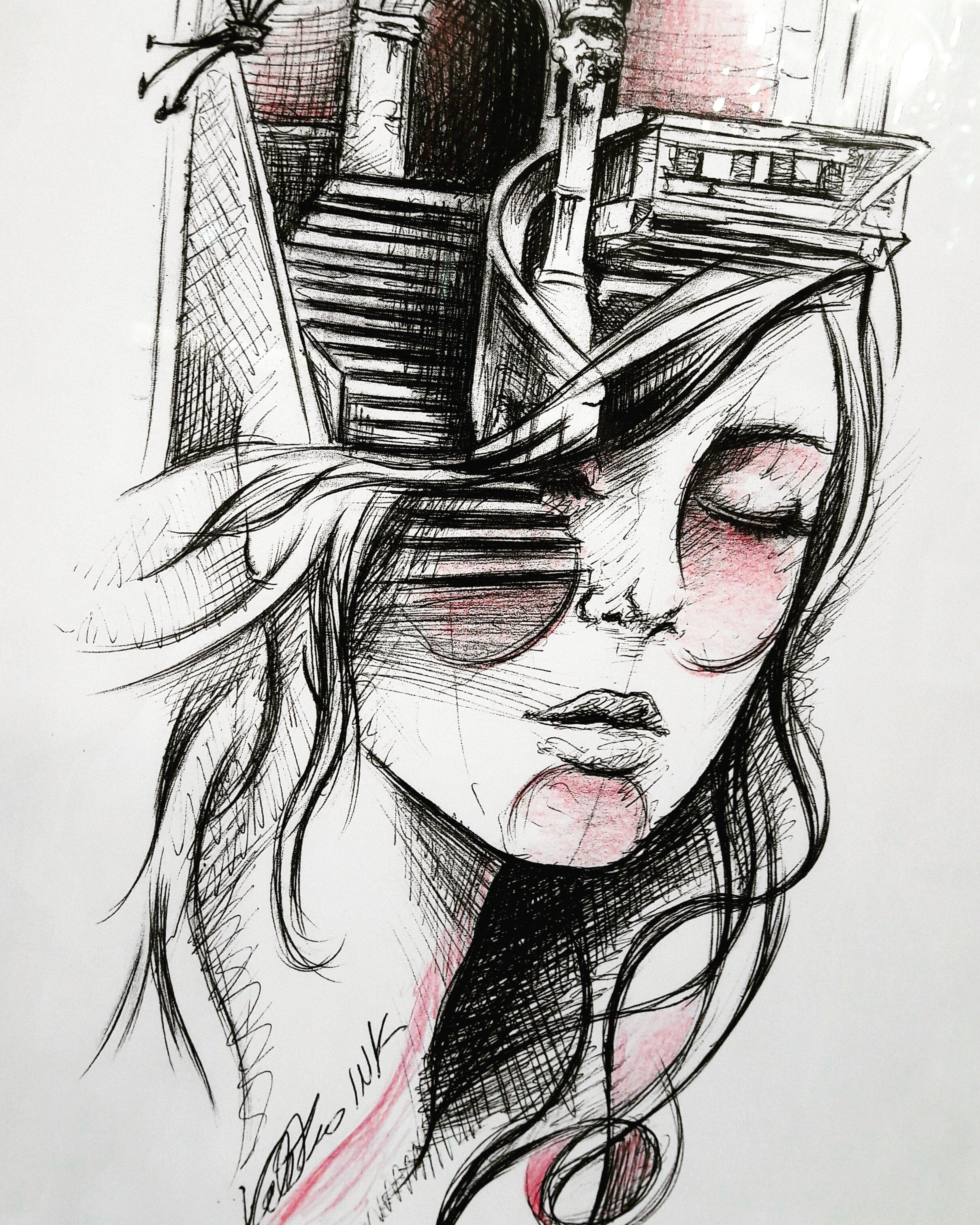 tatuaggio con viso di donna