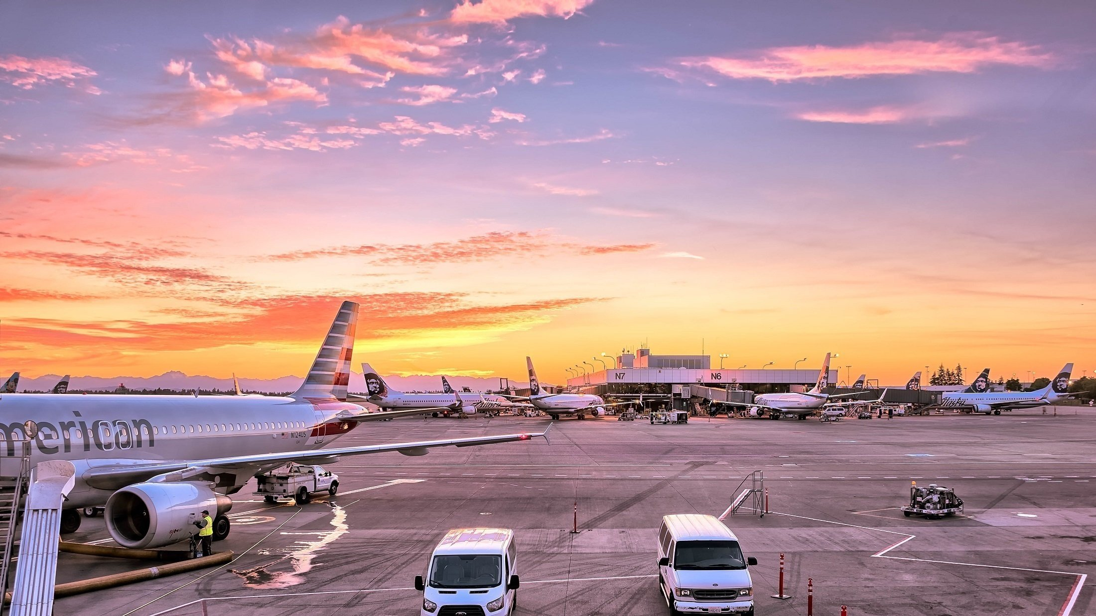View of airplane getting inspected at the airport