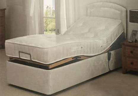 white coloured electric bed