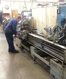 Man performing machine services in Kalispell, MT