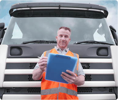 Instructor with clipboard in front of training lorry