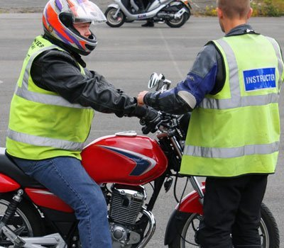 Motorcycle instructor and pupil on a lesson