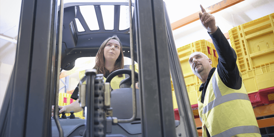 Woman operating forklift
