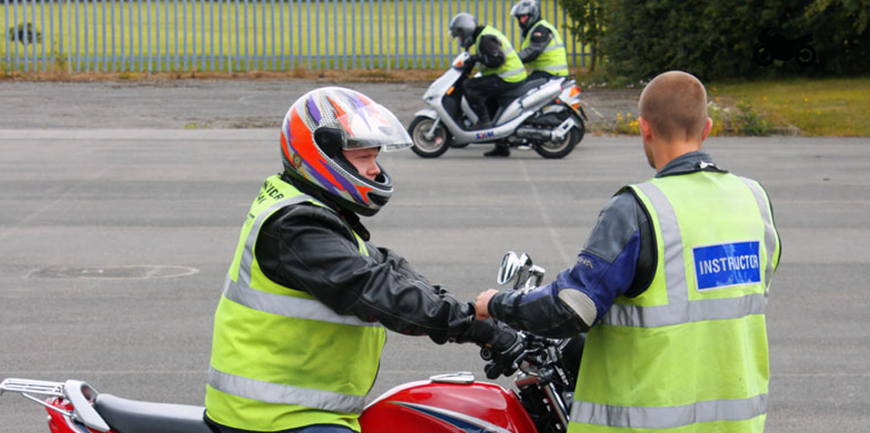Motorcycle instructor and pupil