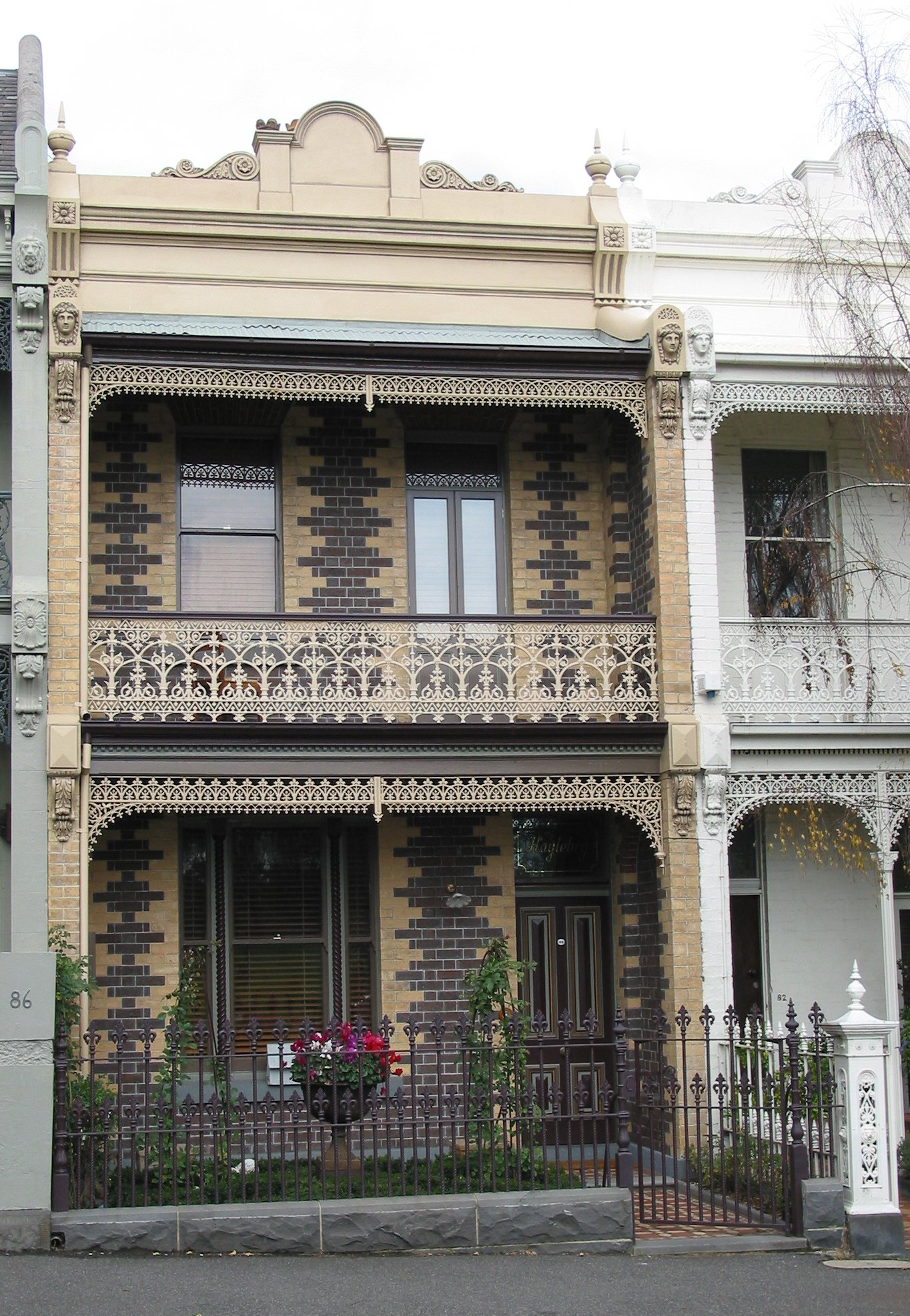 balcony with cast iron balustrades and lacework by Perry Bird Pickets