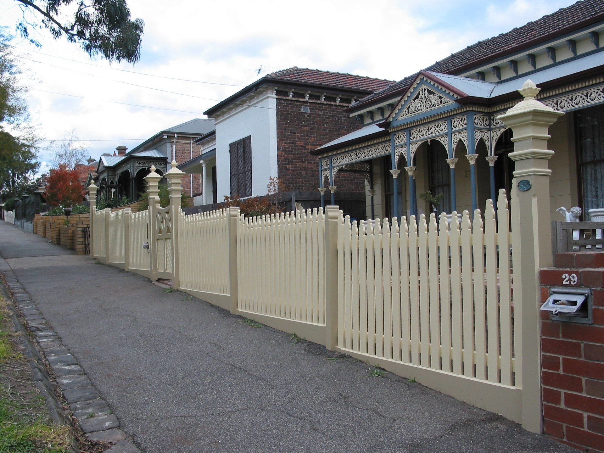 Timber picket fence and lychgate by Perry Bird Pickets