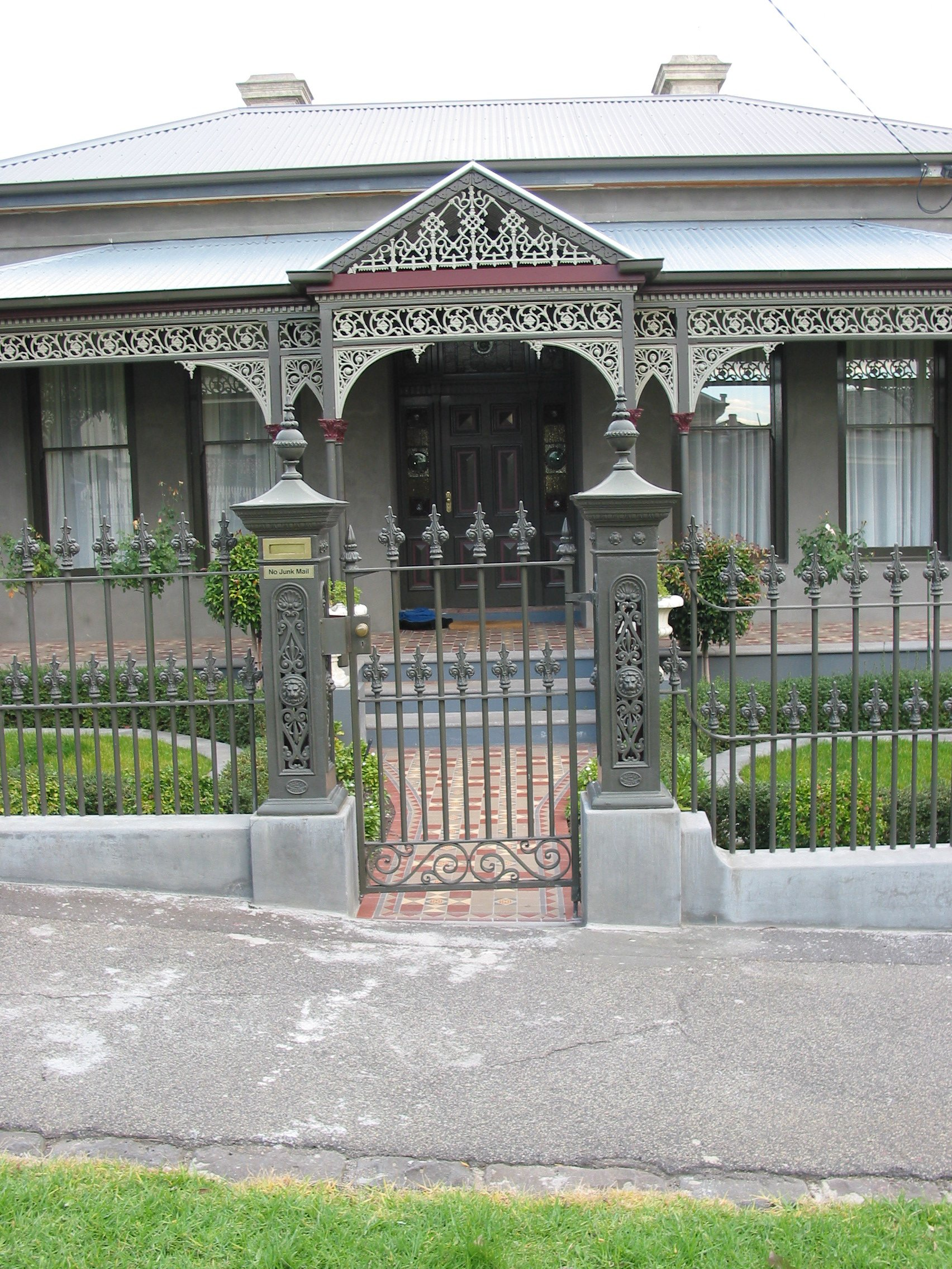 victorian style home with fence