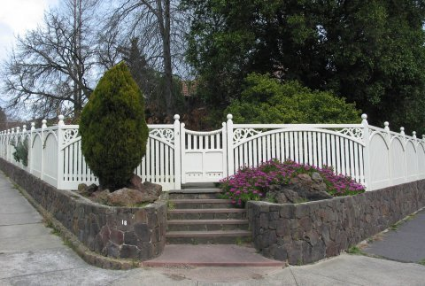 large white painted fencing by perry bird pickets