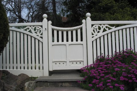 white painted fence and feature gate