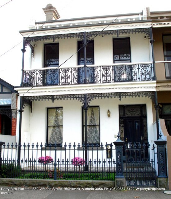 Cast iron fence on Bluestone base and verandah by Perry Bird Pickets