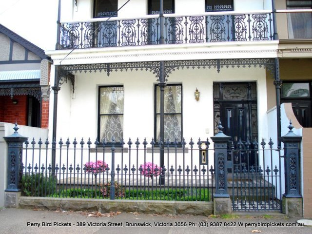 Cast iron fence and gate on Bluestone base by Perry Bird Pickets