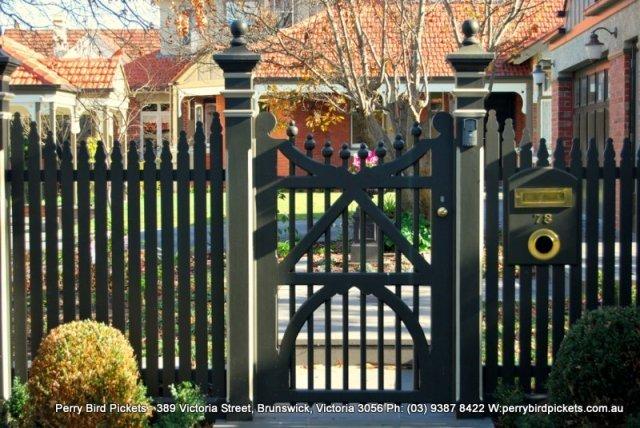 cast iron capitals on fence