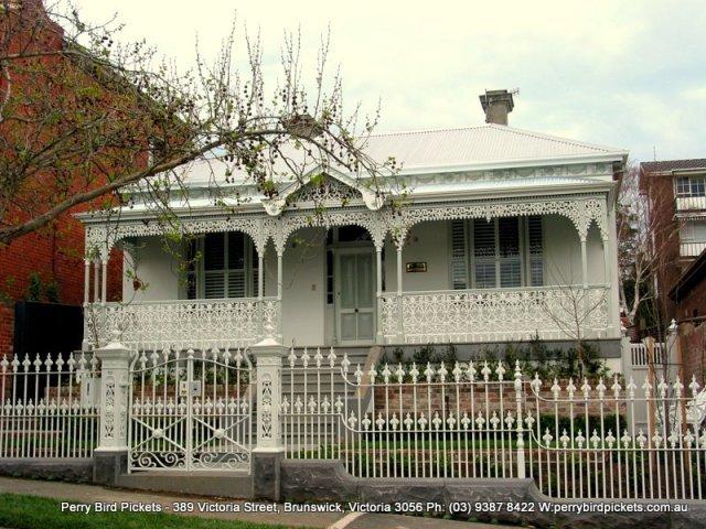 white cast iron fence around edwardian house